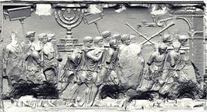 In the most famous of the panels, Roman soldiers carry the Jerusalem Temple spoils on parade, including the menorah, the showbread table and trumpets, which were then deposited in Rome's Temple of Peace. Courtesy Yeshiva University Arch of Titus Digital Restoration Project. http://www.biblicalarchaeology.org/daily/biblical-sites-places/temple-at-jerusalem/jewish-captives-in-the-imperial-city/